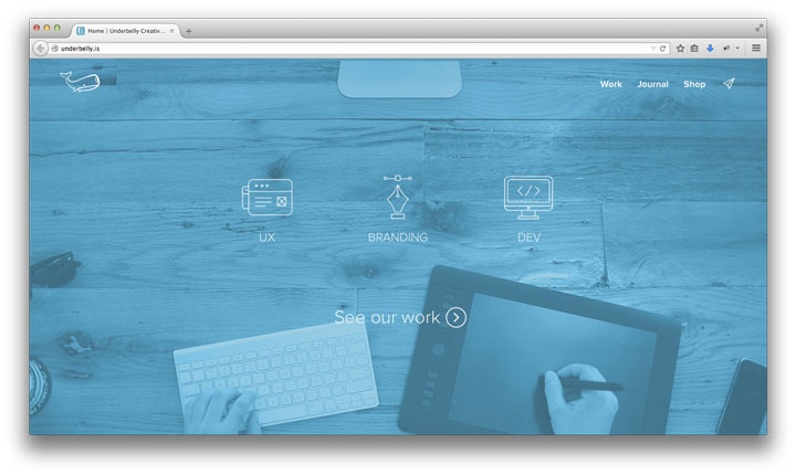 Underbelly.is - Screenshot of creative agency homepage, blue washed desktop, full screen background